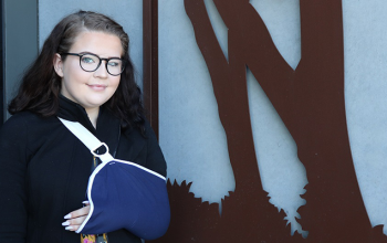 Image of Chloe Backhouse, arm in a sling