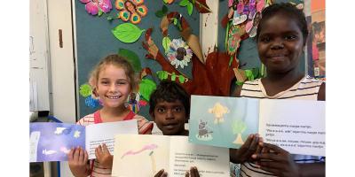 Shepherdson College students Martha Hewett, Joshua Garrawurra and Kiki Gawla display their artwork for Badurru
