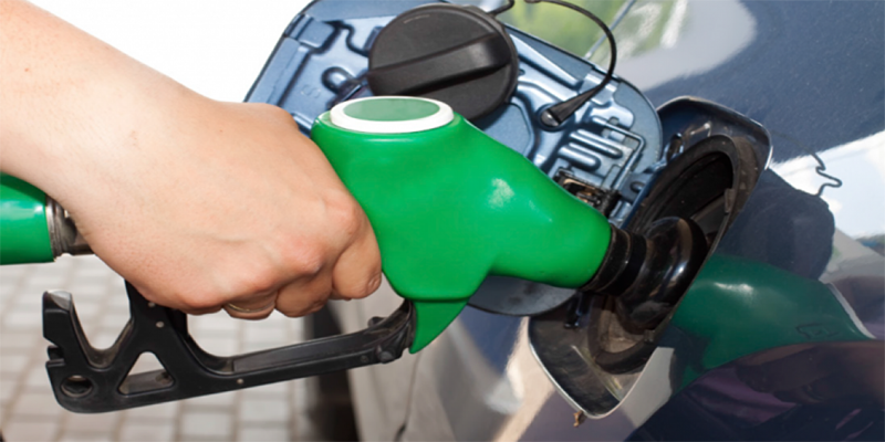 Image of a hand on a petrol pump