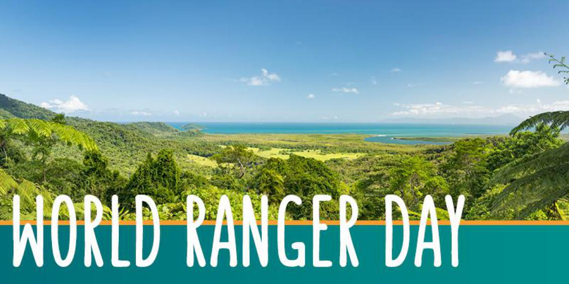 At right is image of rainforest in foreground and sea and sky in the background. At left are the words: World Ranger Day.