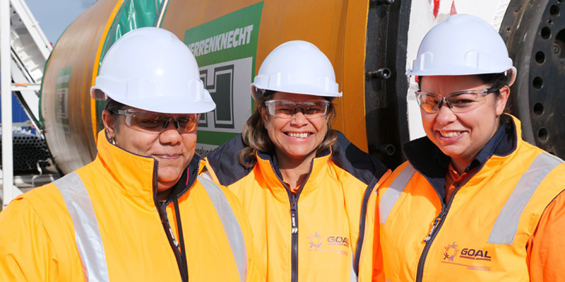 Image of Kristy Stewart and two coworkers outside a drilling engine